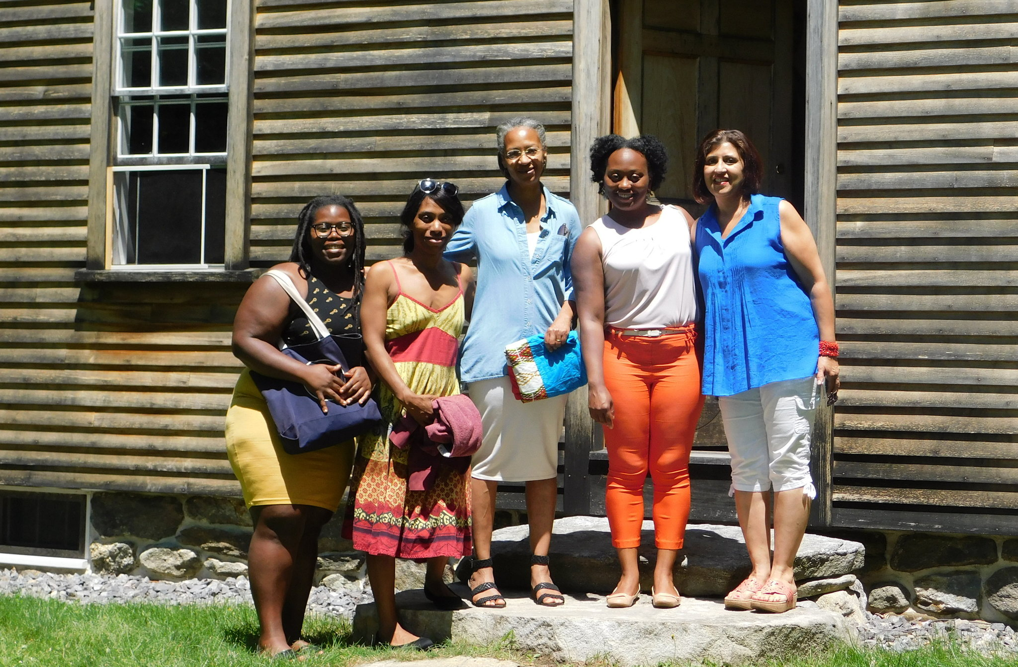 Greenidge sisters Kaitlyn, Kirsten, (left) and Kerri (second from right), here with board members Maria (center) and Punita (right), visit the Robbins House on a road trip in search of strong female role models.