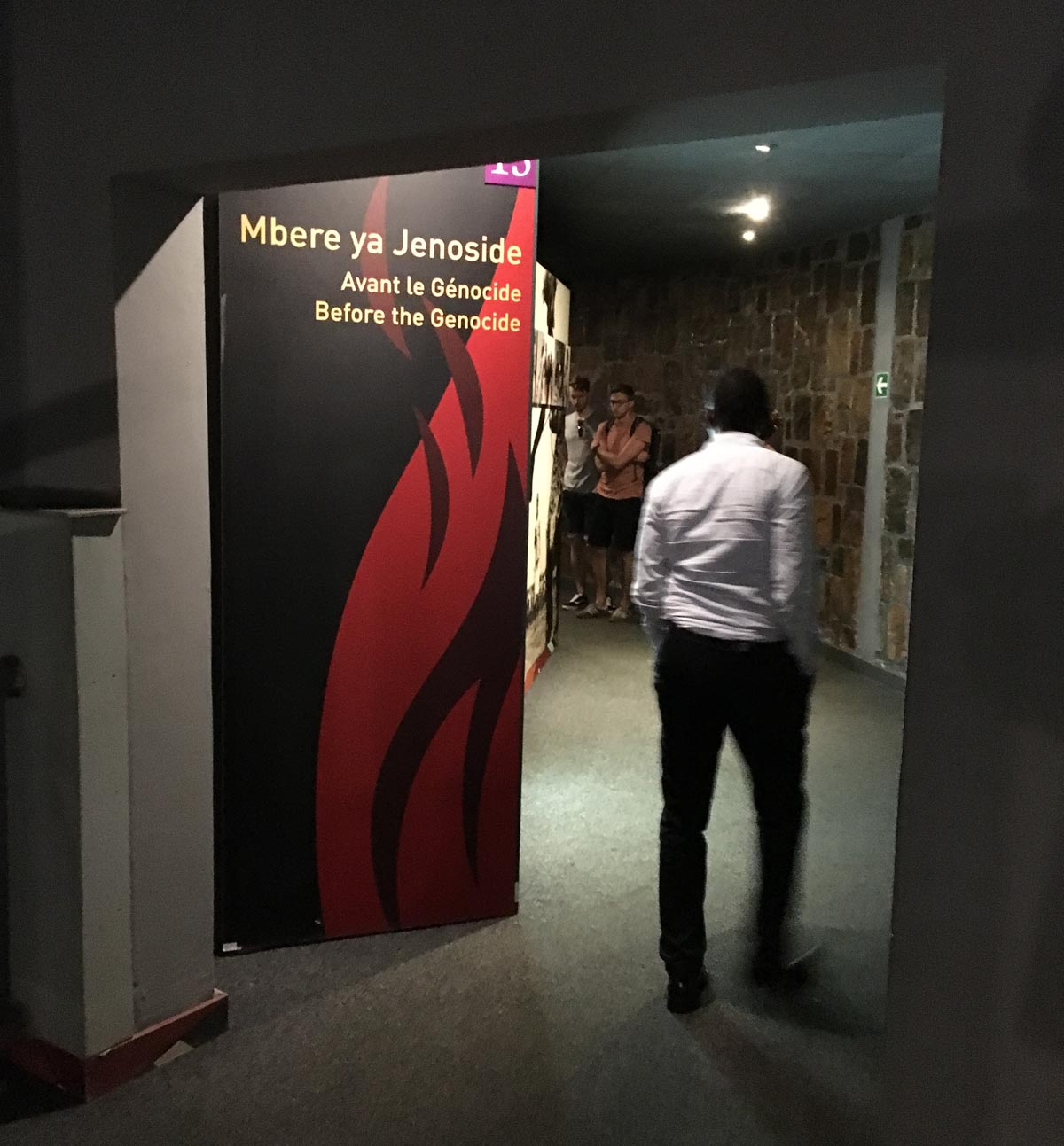 """Entering The Kigali Genocide Memorial (KGM), Visitors Begin Their Visit Through A Passageway Learning About Rwanda """"Before The Genocide."""""""