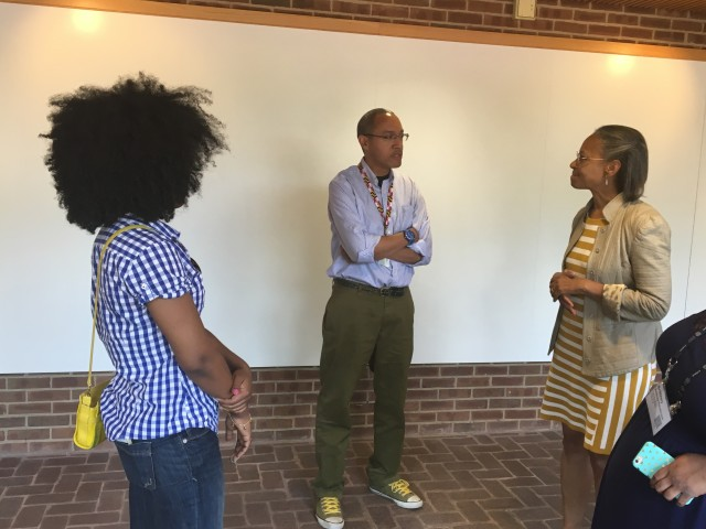 Board member Maria Madison and Director Elon Cook discuss Ellen Garrison Jackson's legal case with Chris Haley, son of Roots author Alex Haley, Director of the Maryland State Archives.